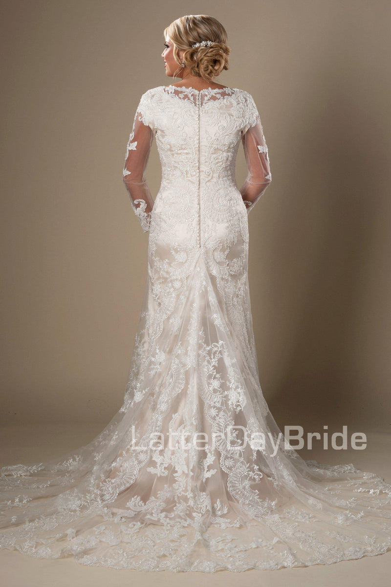 modest wedding dress, visually stunning floral lace softly makes its way from long sleeves all the way down to the train. Tulle and Luxe silky charmeuse lining, modest wedding gown salt lake city, back  view
