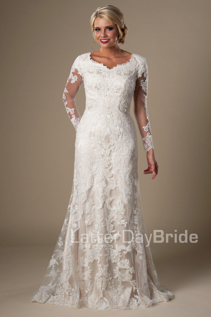 modest wedding dress, visually stunning floral lace softly makes its way from long sleeves all the way down to the train. Tulle and Luxe silky charmeuse lining, modest wedding gown salt lake city, front view