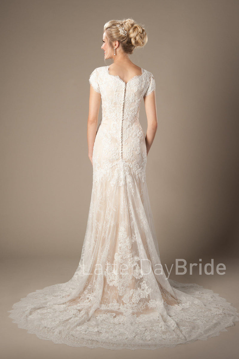 Back of Mermaid silhouette wedding gown with soft lace overlay, style Josephine, is part of the Wedding Collection of LatterDayBride, a Salt Lake City bridal shop.