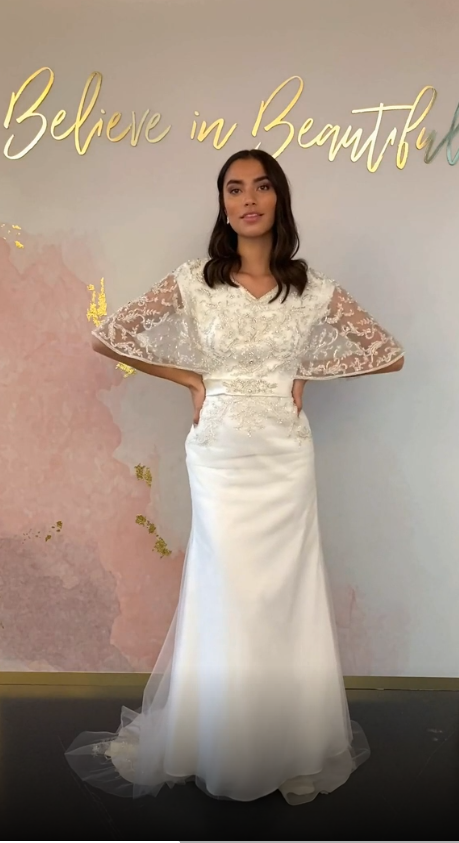 A video featuring our Primrose wedding dress and its beaded butterfly sleeves, waistline detailing, and elegant bodice.