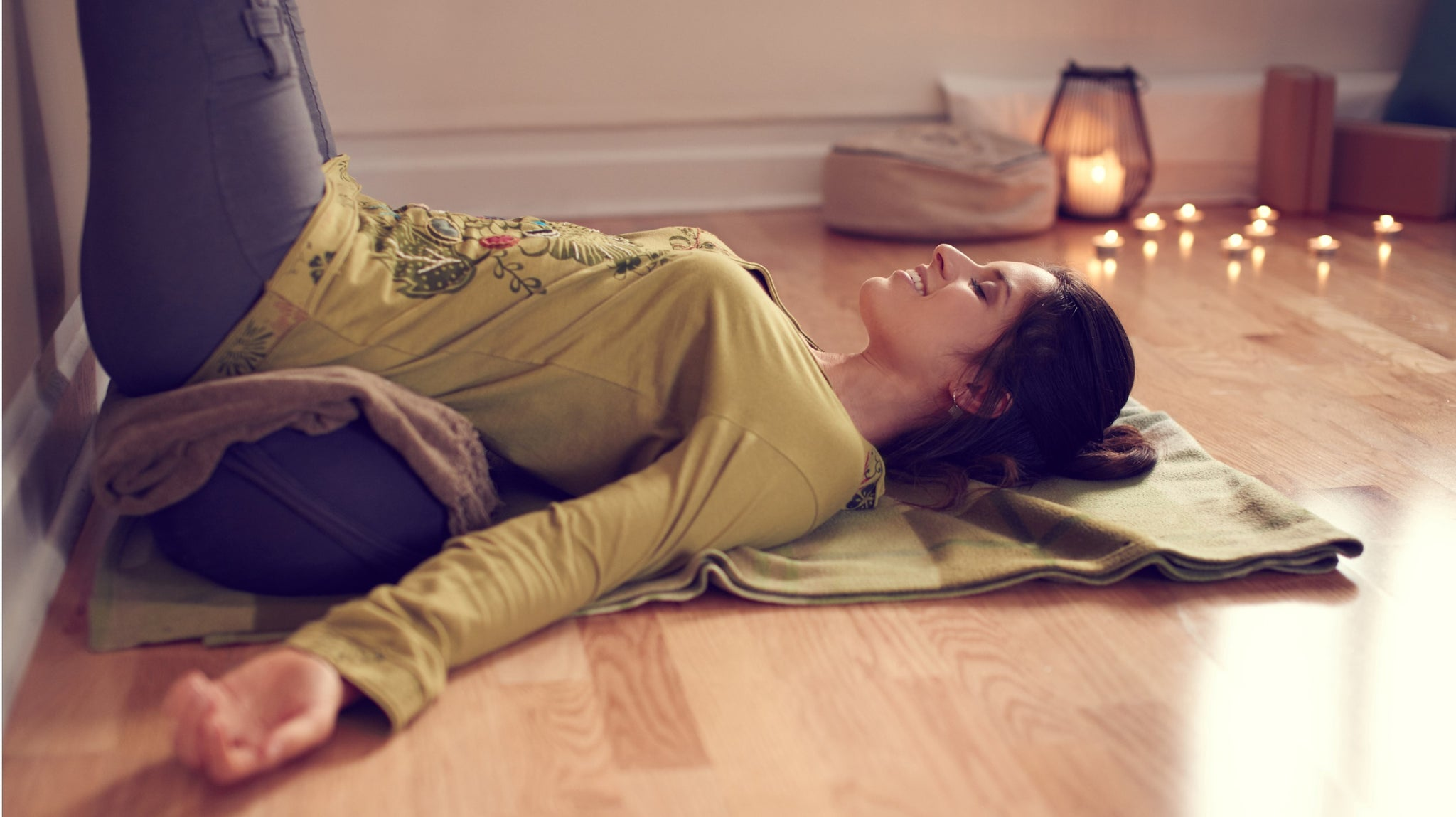 lady practicing restorative yoga