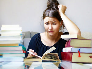 Girl looking stressed studying for exams