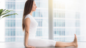 Attractive lady doing yoga pose dandasana - the staff