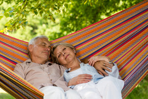 Elderly couple relaxing in a hammock