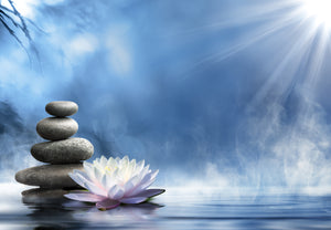 Zen image balancing stones and lotus flower