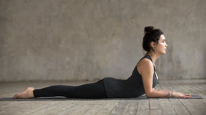 Attractive young woman practicing yin yoga pose