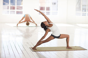 Yoga Students Practicing Yoga in a Studio