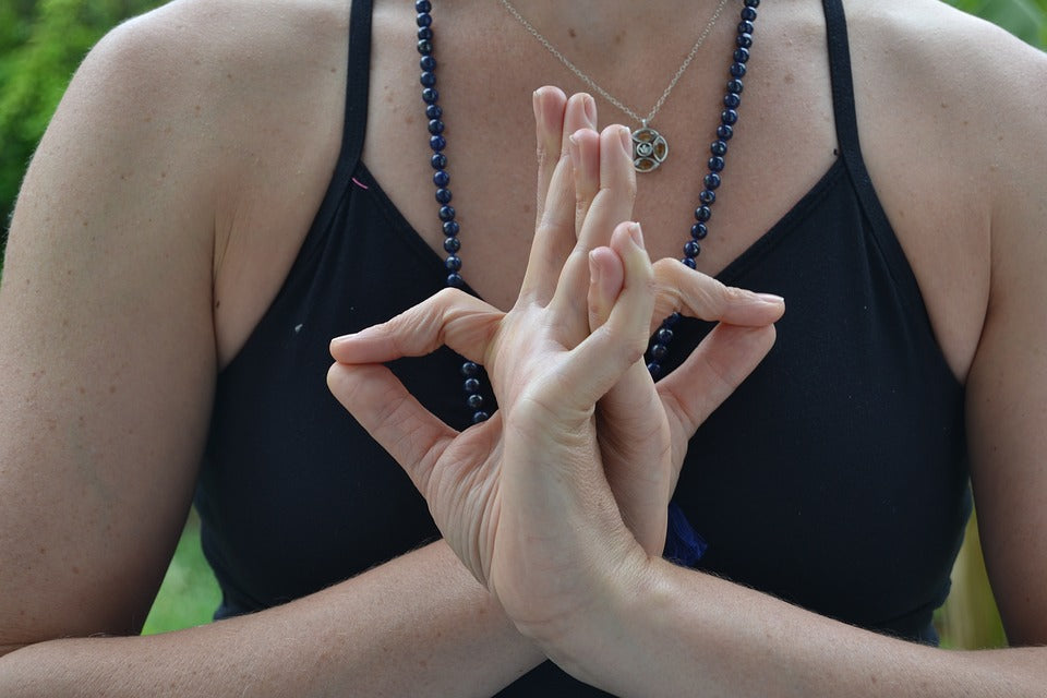 Lady performing yogic hand gesture