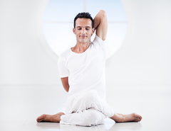 Man performing Gomukhasana yoga pose