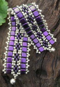 This bead woven bracelet combines velvety Dark Purple Czech Glass tiles with Silver glass seed beads and measures 6 5/8