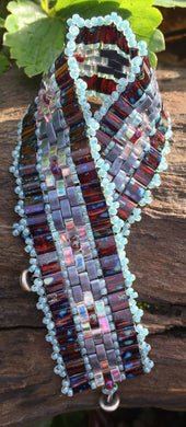 Czech glass Red Picasso Tile beads with Iridescent Crystal and Matte Jet Half Tiles finished with Seafoam seed beads - this Mosaic bracelet measures 7 1/2