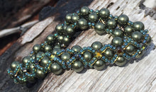 "Load image into Gallery viewer, Dark and sparkly, this Dark Olive glass pearl bracelet is entwined with Capri Blue seed beads and rich warm Swarovski Golden Tabac Crystal Montees. This bracelet has a magnetic closure and measures 7 3/8""."