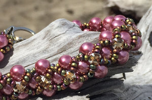 This Rose colored glass pearl bracelet is topped with Topaz Swarovski Montees and Matte Iris seed beads and measures 6 3/4