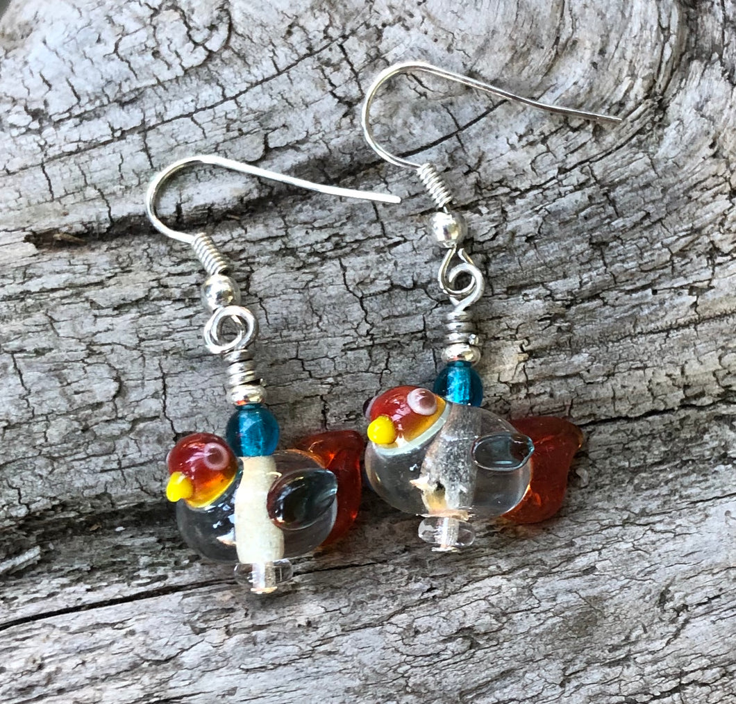 These sweet and tiny clear and orange lampwork glass birds dangles measure 3/4