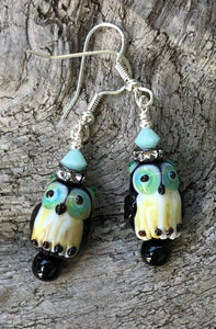 These Black and Aqua Owl Lampwork Glass Earrings are topped with Aqua Swarovski Crystals and measure just under 2