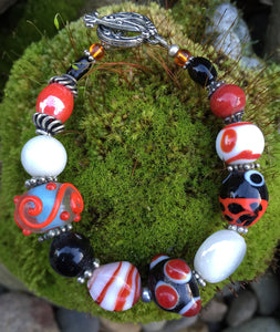 Lampwork Glass Bracelet - Dark Orange Black White and Silver