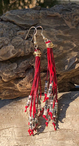 "These Cattail Style Red Leather Earrings with sparkly Black Silver and Clear beads measure approximately 3 1/2""."