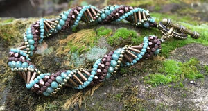 "This earth-toned helix spiral bracelet measures 8 1/2"" and comprises Czech fire-polished beads in turquoise, brown and bronze."