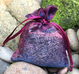 This Burgundy Navy Shimmer Lavender Sachet is useful in diminishing stress, easily fits in a drawer, purse, gym bag, or locker and makes a unique gift. The contents of each sachet is Oregon lavender, and only lavender, thus there are no other fillers. Lavender has plenty of its own natural oils, so give it a gentle squeeze to slightly bruise the buds to draw out more fragrance. This sachet should not be heated or put into a microwave oven.
