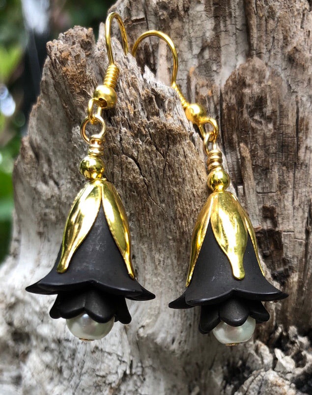 "These Black and White pearl tulip style earrings are light as a feather and hang approximately 1 1/2""."