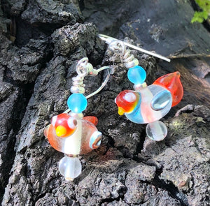"These sweet and tiny clear and orange lampwork glass birds dangles measure 3/4""."