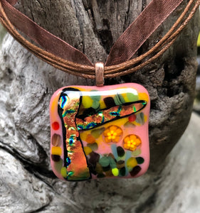 "Autumn Forest includes Dichroic and Murrine, the pendant measuring 1 1/4"" x 1 1/4"", and is completed with a fall brown organza cord, adjustable from 16 1/2"" to 18""."