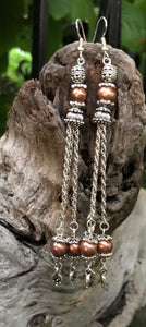 "Dangling almost 5"", these Silver and Copper bouncy tassel earrings make quite a statement!!"