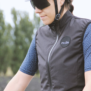 Woman wearing Relm Cycling black patch gilet and Alba Optics Sunglasses