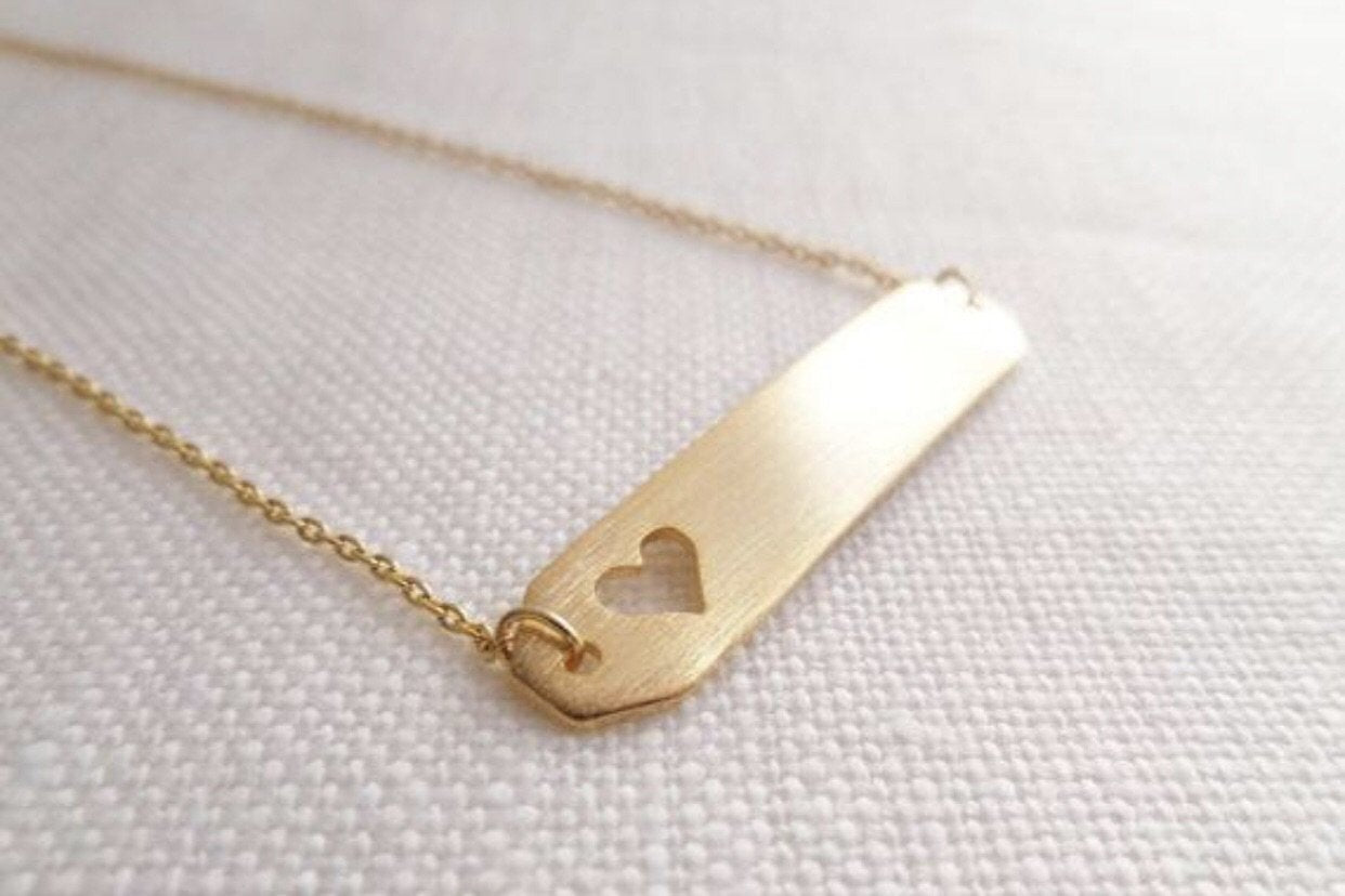 Open Heart Bar Necklace: available in silver, gold, and rose gold.