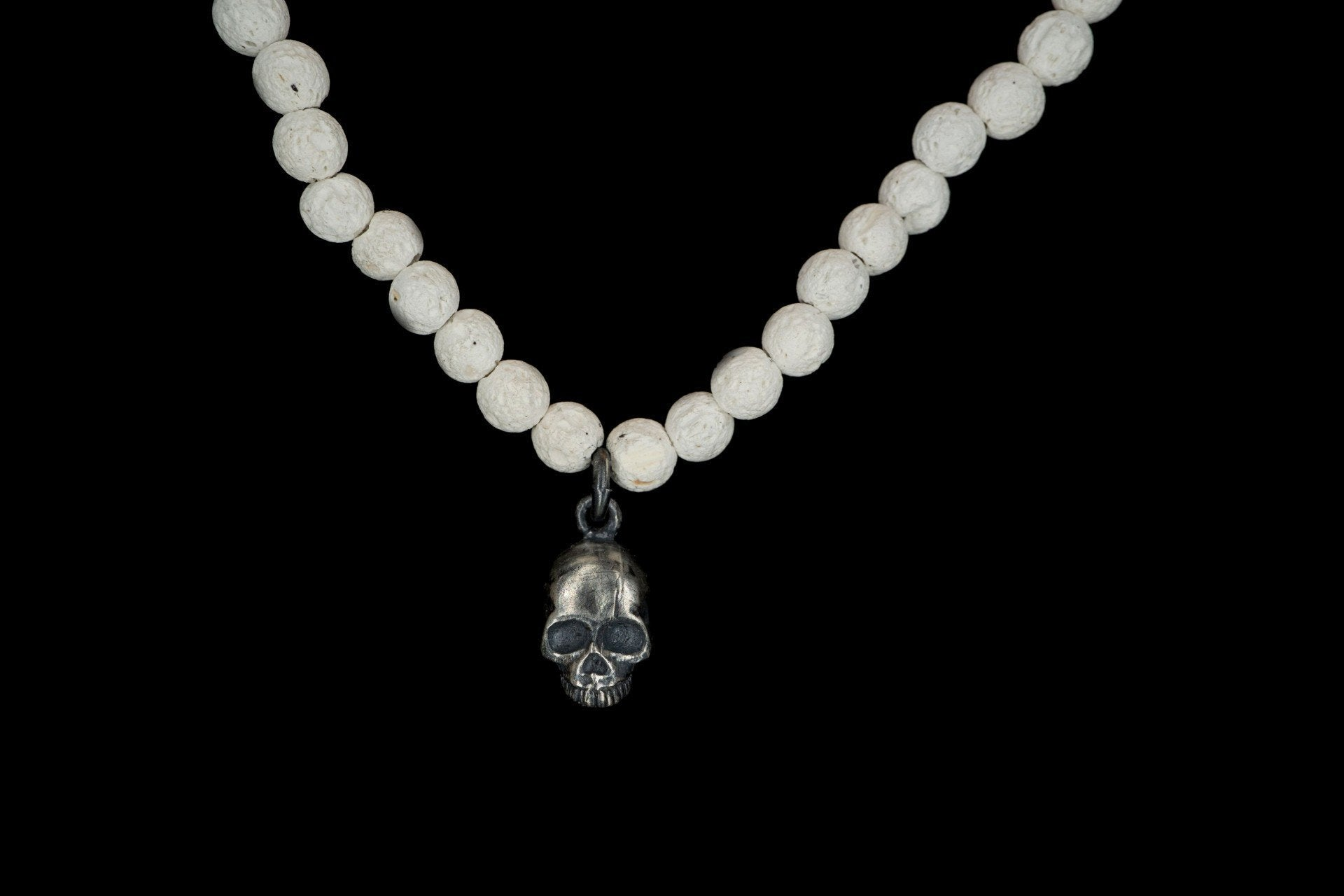 WHITE VOLCANIC ALICE SKULL NECKLACE