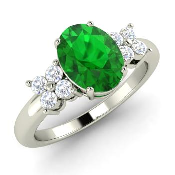 1.27 carat emerald and diamond sidestone ring in 14k white gold