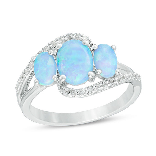 October Birthstone Rings - oval lab-created blue opal and white sapphire three stone bypass ring in sterling silver