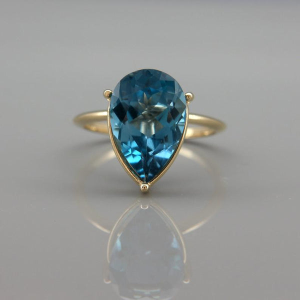 14k gold pear cut London blue topaz December birthstone engagement ring