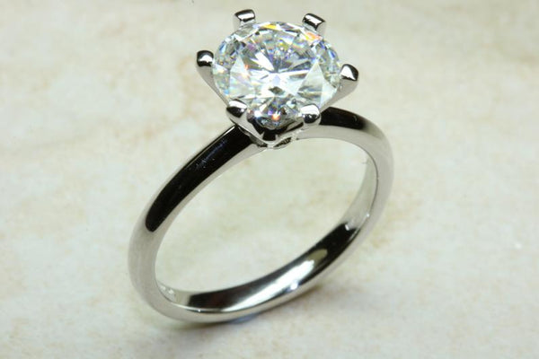 One carat forever one diamond solitaire six claw platinum ring