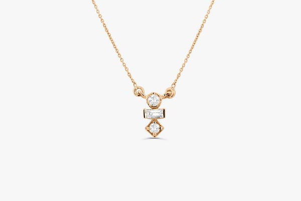 Minimalist 14k gold baguette and round cut diamond necklace