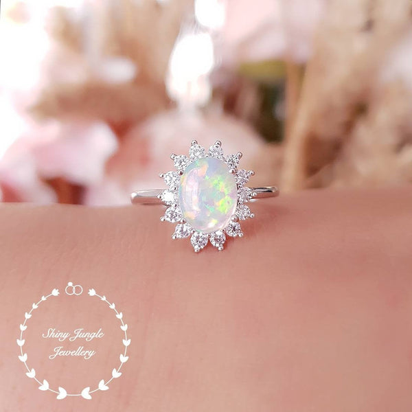 October Birthstone Rings - halo white opal cabochon October birthstone promise engagement ring with diamond simulants
