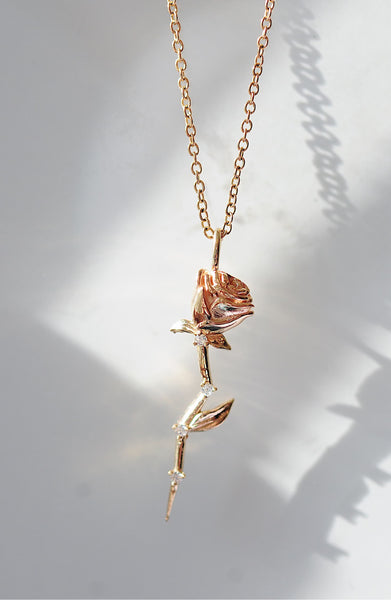 Diamond Chain Necklaces - 1/10 cttw natural diamond and pear shape blue sapphire in 10kt pink gold fashion pendant
