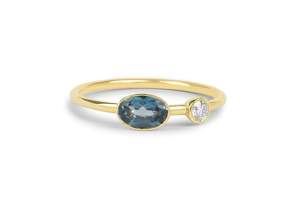 Oval shape bezel setting 14k London blue topaz December birthstone ring with diamond