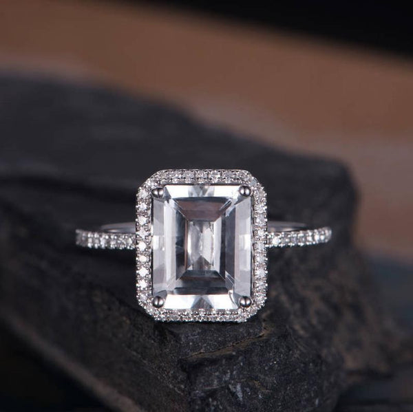 Emerald cut white gold diamond halo half eternity white topaz minimalist classic December birthstone anniversary engagement ring