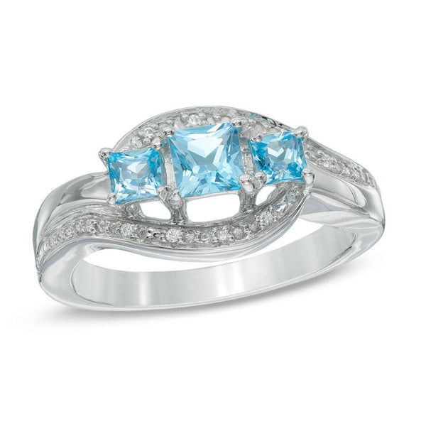 Princess-cut blue topaz and diamond accent three stone swirl promise ring in sterling silver