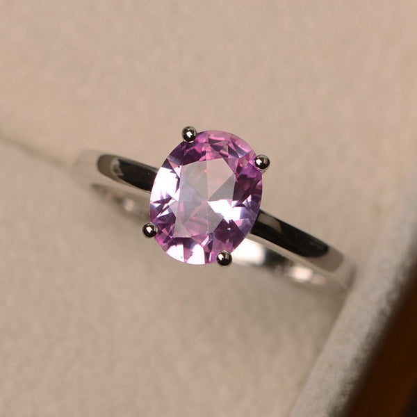 Oval cut pink sapphire gemstone solitaire engagement ring