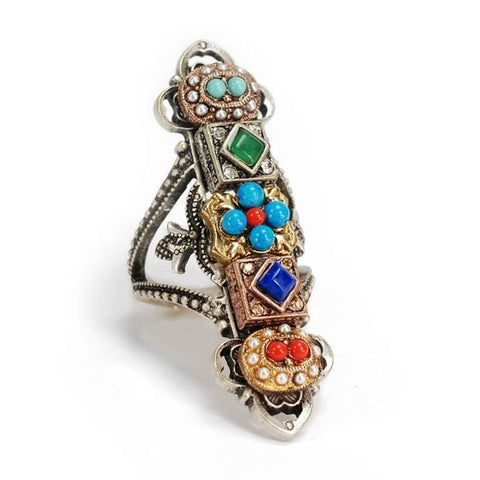 Elongated fashion ring with colored stones