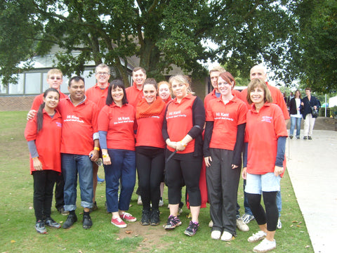 A group of Hi Kent staff and volunteers wearing red Hi Kent shirts.
