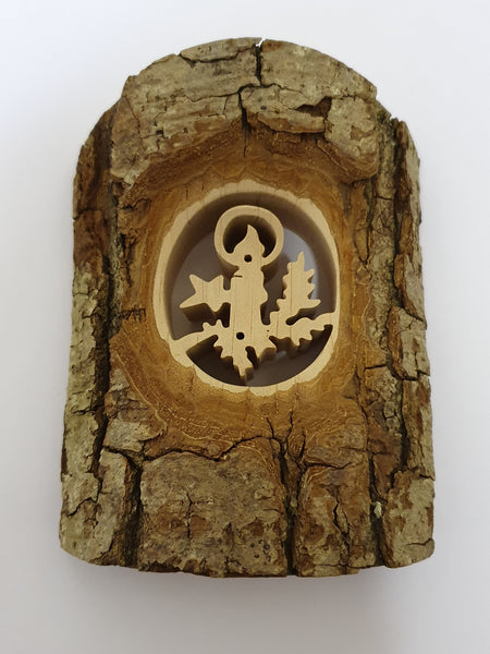 Bark Covered Wood with Cut Out Candle Scene
