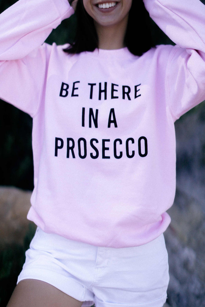 be there in a prosecco sweatshirt, be there in a prosecco pink sweatshirt, prosecco sweatshirt, sweater dress, white sweater dress, women's sweater dress, sherpa jacket, tie dye sweatshirt, tie dye set, tie dye hoodie, pink hoodie, knit sweater, cable knit sweater, pink sweatshirt, black jumpsuit, tie dye shirts, snakeskin print dress, bellbottoms, lilac blazer, fluffy sweater, loungewear, pink leopard loungewear set, sale, lingerie, plus size clothing, champion sweatshirt