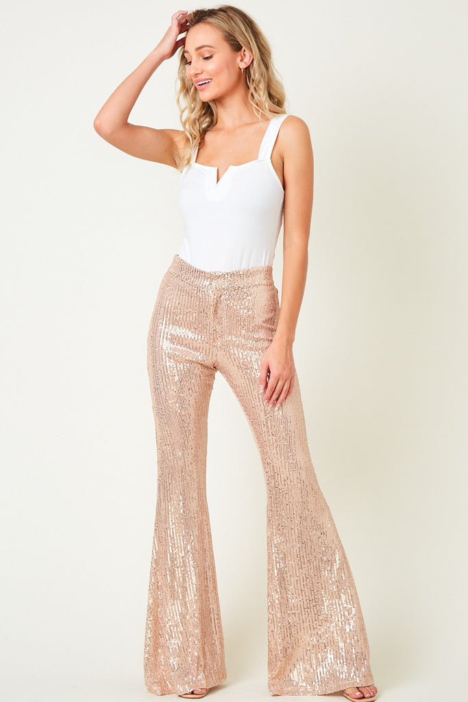 sequin bellbottoms, rose gold sequin bellbottoms, rose gold sequin flare pants, sequin flare pants, new years eve outfit, happy holidays, merry christmas, christmas outfit, christmas dress, christmas party dress, corduroy, maxi dress, corduroy bell bottoms, black lace maxi dress, santa claus sweatshirt, chenille sweater, velvet wrap dress, leopard print lounge set, sequin blazer, sequin joggers, loungewear, new years eve outfit, holiday outfits, sweater dresses