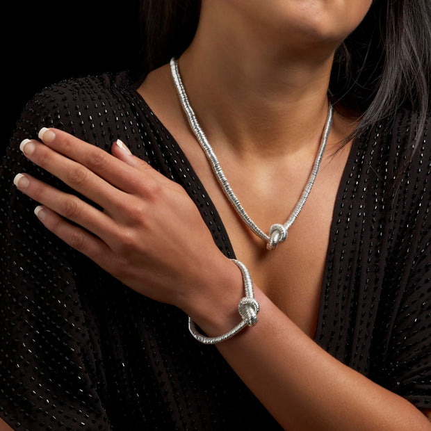 Telesto knotted silver bracelet & necklace