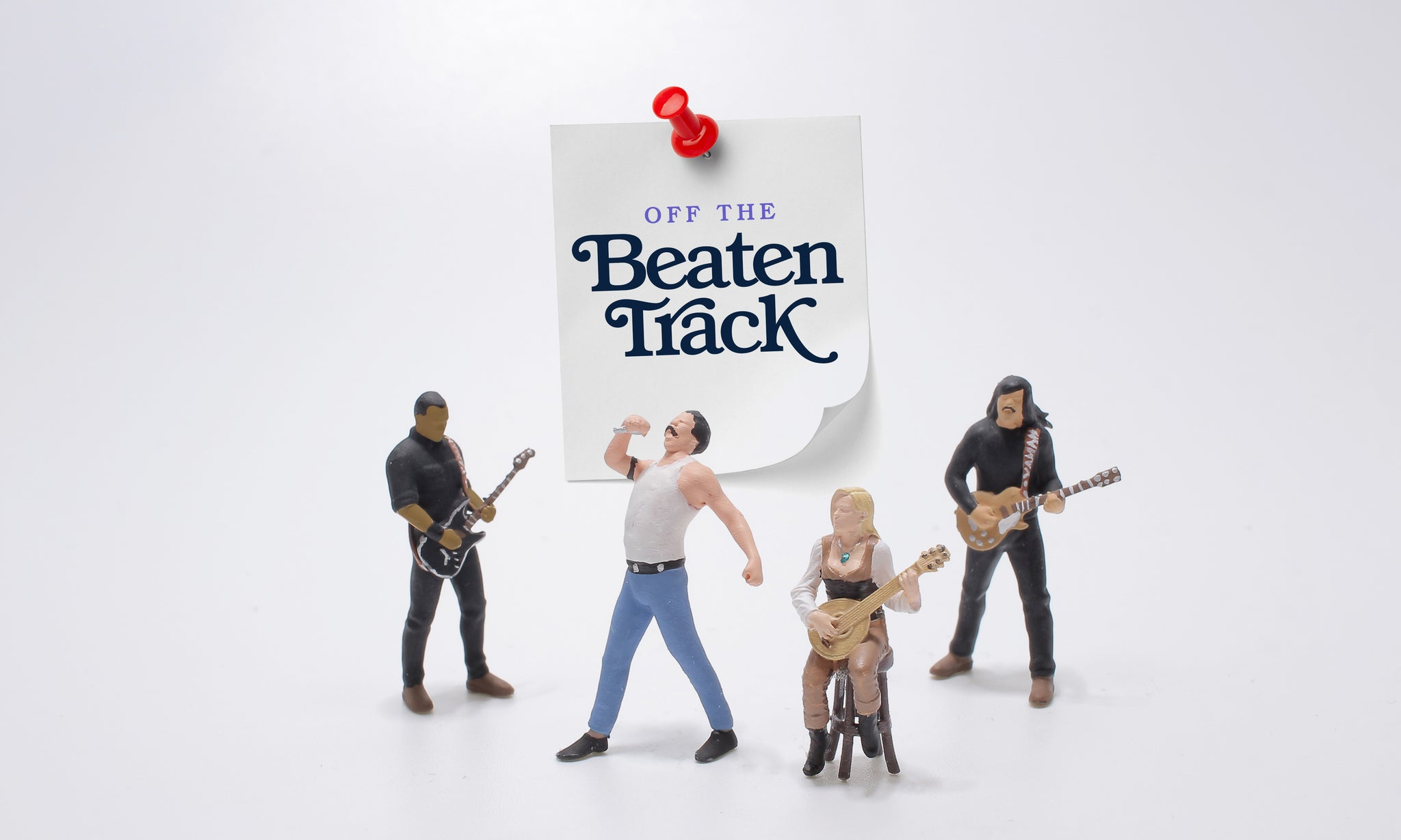 Off the beaten track. Toy pop band playing music.