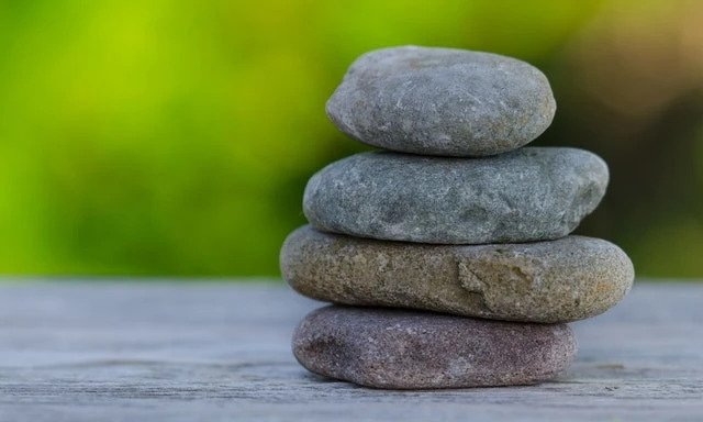 three pebbles balanced on top of each other