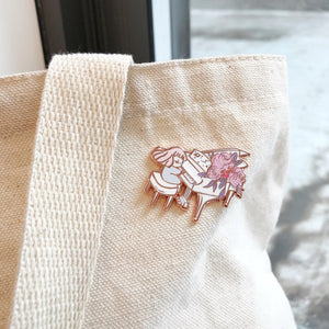 Rose gold piano enamel pin with florals on natural tote bag